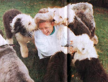 Gerry House plays with her sheepdogs